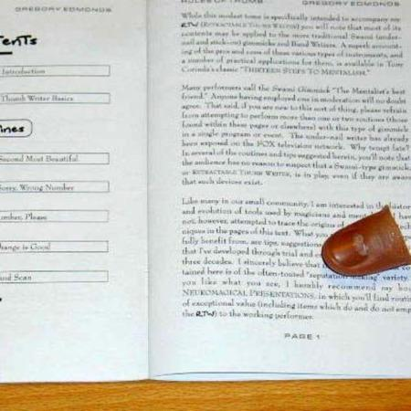 Retractable Thumb Writer (RTW) by Gregory Edmonds