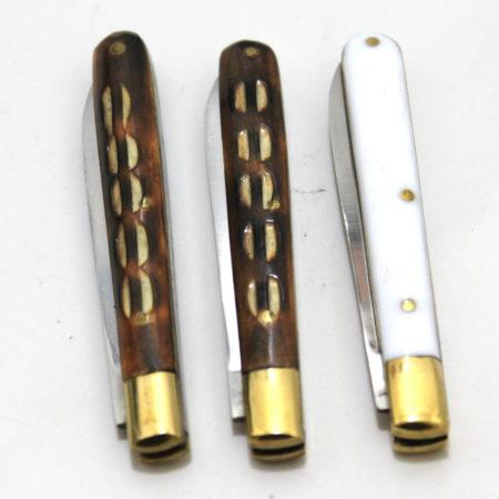 Jigged Bone Handle Knives with Purses by Joe Mogar